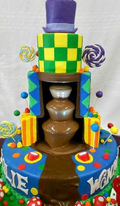 Charlie and the Chocolate Factory Cake ~ Cake with a running chocolate fountain built into the frame. Adorned with edible handmade candies