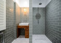 Full renovation on Trinity Road, London : Modern bathroom by Grand Design London Ltd