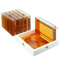 Creative honey packaging - reminds me of honeycomb plates inside of a beekeeper's hive. http://design-cookies.blogspot.com/2008/11/honey-iii_11.html?m=1