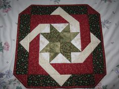 Name:  IMG_16000.jpg  Views: 5788  Size:  1.67 MB Cinnamon Twist Topper Not my favorite, but it's square. I do like the angled corners with the design.