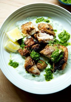 Smokey grilled chicken with cucumber-yogurt sauce — this is one of my all-time favorite summer grilling recipes. It's fast enough for a weekday but fun enough for entertaining. The marinade for the chicken is super simple as is the cucumber yogurt-sauce. I love serving this with skhug, an herby, spiced sauce, and naan or pita — I like that Stonefire naan brand. #chicken #grilling #summer #smokey #skhug #cucumber #yogurt