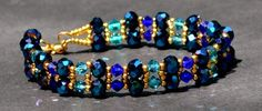 3X5mm rondelles, 4mm rounds (pearls, also0 or bicones, 11/0 seed beads--(Sample in with seed beads --PH)