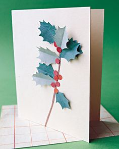 Holly Card  A sprig of holly springs to life from atop a store-bought plain note card. This project won't fare well in the mail, so save it for greetings you're planning to deliver by hand.