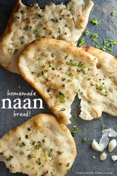 Soft and chewy naan bread with chunks of garlic and green onions
