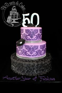 Fifty & Fabulous! Fondant-covered cake with black ruffles and purple Damask stenciling.
