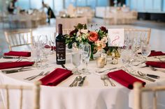 {{Late summer wedding centerpiece in gold compote with garden roses in coral, blush spray roses, and red dahlias at Galleria Marchetti in Chicago.}} Photography by Laura Fisher Photography http://www.laura-fisher-photography.com/ || Flowers by Pollen, pollenfloraldesign.com