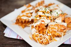 Buffalo Chicken Waffle Fries recipe from Buns In My Oven