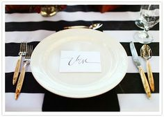 black, gold and stripes table setting