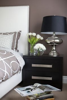 Clean lines and rich dark taupe walls with black-brown wood furniture. The…