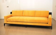 yellow sofa with tan walls | Fabric Back Seat Modern Yellow Sofa With Black Wooden Legs On Brown ...