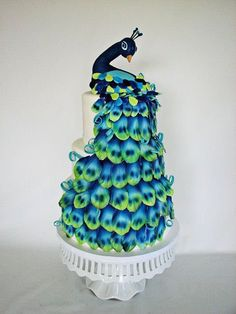 Pretty in peacock - Certainly not the glamour of a traditional wedding cake...but this cake turned out glamorous nonetheless! For a peacock themed wedding at an apple orchard in Vermont layered with organic pumpkin cake with Vermont maple buttercream.
