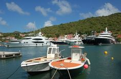 Buoyant economy: Mega-yachts belonging to the rich and famous moored in Gustavia harbour on St Barts. Daily Mail, By JAMES HENDERSON. 24 Feb 2013