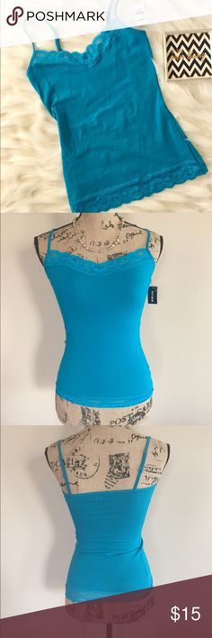 """NWT Express lace trim cami NWT teal cami from Express is trimmed with scalloped  lace at front of neckline and entire hem. V neck, adjustable spaghetti straps, fitted shape. Size XS. 95% cotton 5% spandex. Machine wash. Bust measures 14"""" flat, length 23"""". Express Tops Camisoles"""