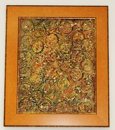 Mixed color and texture in gold frame.