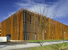 Hofmeister Office Building By Hertl Architekten - The office building in Austria designed by Hertl Architekten looks like a log cabin, with its thin steel sheeting covering the entire volume like a second skin.A volume of three floors covered with a second skin. Of thin sheet steel filter the view, protecting the street and looks...