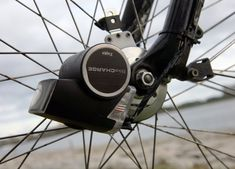 This gadget connects to your bike wheel and converts energy for your USB devices! ( #gadget #technology #bike #biking #cycle )