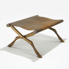 i am guessing that this would be classified as an diphros, Greek for stool.   T.H. Robsjohn-Gibbings Diphros Okladias stool Saridis of Athens United Kingdom, 1963 olive wood, leather, brass