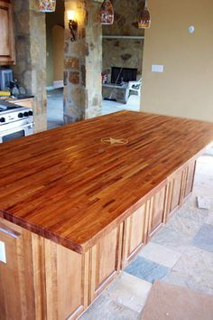 Hugh Mesquite edge grain center island top with 5 point Texas star inland in Maple