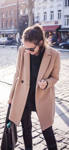 Paulien Riemis is wearing a camel coat from Massimo Dutti