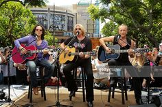 Vivian Campbell, Joe Elliott and Phil Collen of Def Leppard perform at 'Extra' at The Grove on June 1, 2012 in Los Angeles, California.