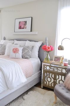I switched to white, bright, and simple. My accent is this beautiful blush quilt from HomeGoods where I also found these white with grey stitches euros. It has just enough pink to keep my bedroom light and airy. It feels like I'm on vacation when I wake up in this bed! Sponsored by HomeGoods