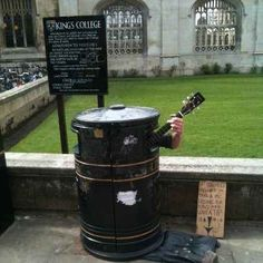 This guy who won't let a garbage can stop him from becoming a rock star. | 26 People Who Made The Best Of An Unfortunate Situation