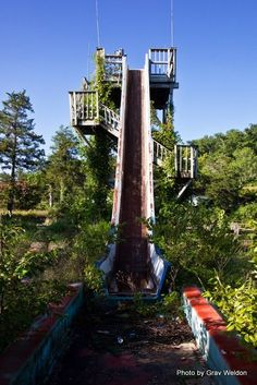 Old log ride at Dogpatch, NW Arkansas 37 Images Of The Eerily Beautiful Way Nature Reclaims What We Abandon