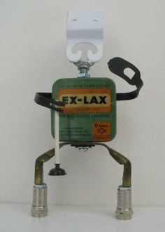 Junkbotworld.com - RECYCLED ART ROBOT CONSTIPATED CARL GETS A PLUNGER VINTAGE EXLAX TIN ROBOT 49.00 FREE SHIPPING
