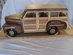This is my 1948 Ford Woodie Station Wagon that my husband built for me.  It is Walnut and Maple