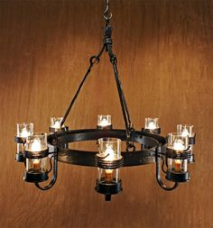 Love this chandelier.  Great idea for those old iron wheels.