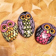 Owls painted on rocks by Linda Hallett.
