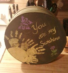 Painted an old cheese box and added person touches with children's hand print rays of sunshine! Love how it turned out!!