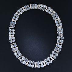 Twenty-one subtly graduated links each contain four shining high-domed cabochon moonstones (84 in all) in this early-to-mid-twentieth century necklace, handcrafted in silver. 15 inches of celestial beauty; about 5/8 inch - 3/8 inch wide.