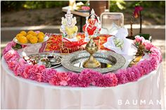 Colorful Puja table for Indian Engagement Ceremony.   Japanese Friendship Garden Engagement Party, Photography by Bauman Photographers  http://baumanphotographers.com/blog/san-diego-engagement-photography/2016/06/balboa-park-indian-puja-engagement-ceremony-san-diego-pritha-luve/