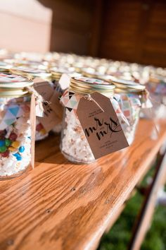 Edible wedding favor idea - homemade popcorn in mason jars {Benjamin Clifford Photography}