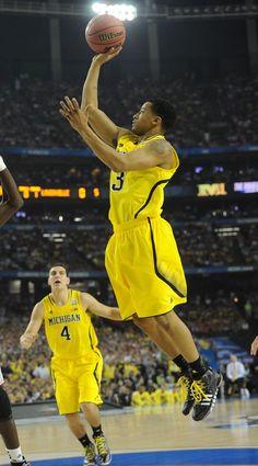 Johnny Crawford Michigans Trey Burke shoots the ball.