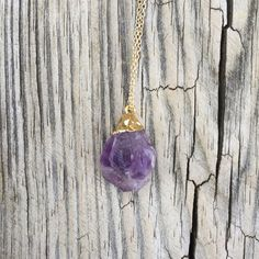 "Amethyst Necklace Raw Amethyst Necklace on gold plated chain. Chain is 24"" in length with a 2"" extender. Pendant itself is approximately 1"" in length.  #1 Buddha's Moon Jewelry Necklaces"