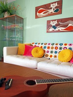 Oh granny square blanket, I need you in my life! // Viviana Agostinho's living room on A Beautiful Mess