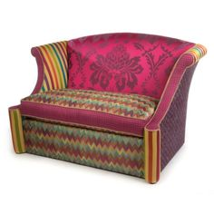 A Broadway melody of magic, wit, and candy-striped enchantment; furniture so deliriously offbeat, it is welcome anywhere. The Kaleidoscope Loveseat features a vivid fuchsia seat back with a fabulous floral design, surrounded by zigzags, stripes, and Bittersweet Checks. Upholstered in blended poly, nylon, silk and rayon fabrics, trimmed in cotton cording, over a hardwood frame. Made in the U.S.