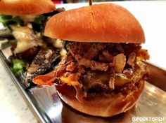 The latest edition to the Union Market at The District in Tustin is Hatch - a variety of sliders and cocktails that will transport you back to the mid-century.  Featured here is the Hatch: all beef patty fried onions hatch sauce & cheese.