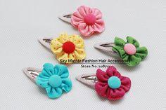 Google Image Result for http://i00.i.aliimg.com/wsphoto/v0/556182404/Summer-New-Item-Kid-s-cotton-polka-dot-sun-flower-hair-pins-hair-barrettes-fashion-hair.jpg