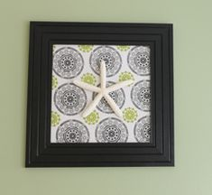 Nautical themed art from an old frame and a kitchen towel!  You are going to love how quick and easy this great tutorial is!