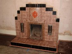 """A """"deluxe"""" version of the quintessentially 1930s tiled living room fireplace, with built-in electric radiant heaters on either side of the main fire opening!"""