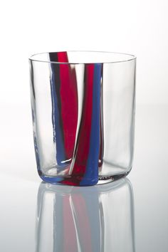 Designed by Carlo Moretti and made in Murano, Venice, these mouth blown cristal glasses are uneven shaped like if a gust of wind bent them s...