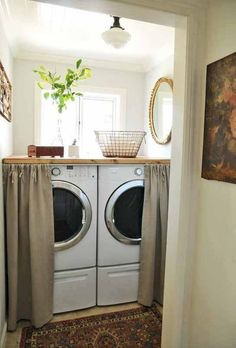 Great idea...hide the washer and dryer behind a curtain! #laundryroom