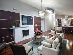 David spent $800 of the team's budget creating the purple-paneled feature wall, firplace surround and updated mantel, as seen on HGTV's Brother Vs. Brother.