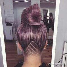 "amethyst coloured hair in topknot up do with inverted ""v"" clippered and shaved undercut"