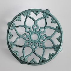 Bonjour, Vintage cast iron trivet from France, a lovely design and beautiful French white coloured enamel ( old blue/green colour ) In very