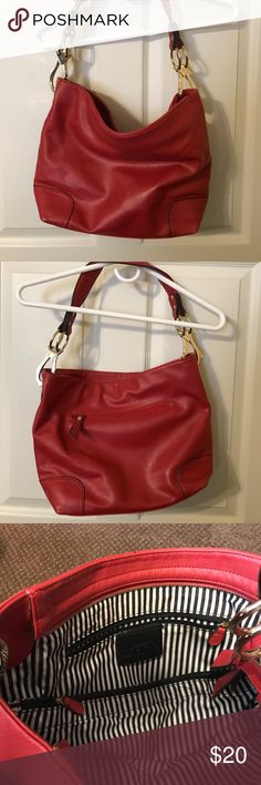 Charming Charlie Slouch Bag. In great condition. Charming Charlie Slouch Bag. In great condition.   Red and blue/white in middle. Outside zipper pocket. Inside zipper pocket two pockets on the inside one large pocket in the middle Charming Charlie Bags Shoulder Bags