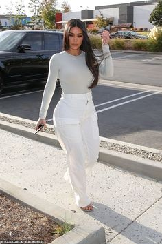 Kim Kardashian highlights her slim waist in gray bodysuit in LA - Kim Kardashian highlights her slim waist in bodysuit with high-waisted trousers while stepping out - Estilo Kardashian, Kardashian Style, Kardashian Clothing, Kim Kardashian Blazer, Kardashian Nails, Kim Kardashian Pregnant, Kardashian Wedding, Robert Kardashian, Classy Outfits